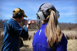 Teaching Andrea how to shoot the rifle